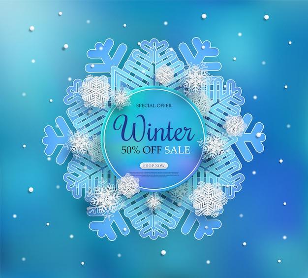 Banner de rebajas de invierno con un clima frío estacional. y copos de nieve blancos.