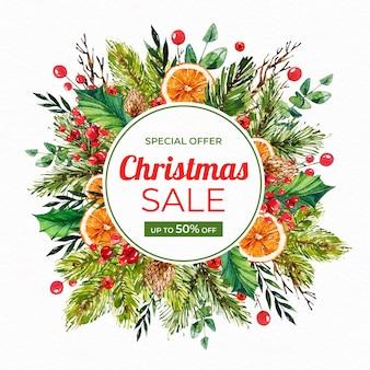 Banner de rebajas de navidad en acuarela con ramas y rodajas de naranja
