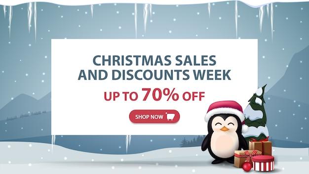 Banner de semana de rebajas y descuentos de navidad con pingüino con regalos