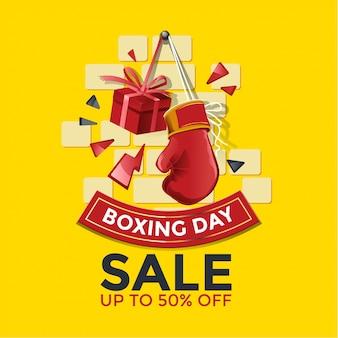 Banner de venta del día del boxeo con guante y caja de regalo ilustración