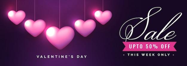 Banner de venta del día de san valentín con corazones románticos