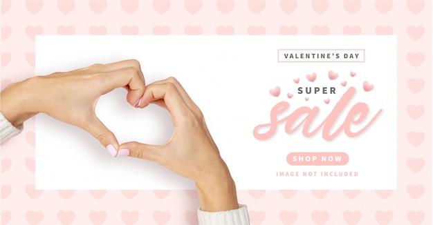 Banner de venta de feliz día de san valentín con patrón de corazones