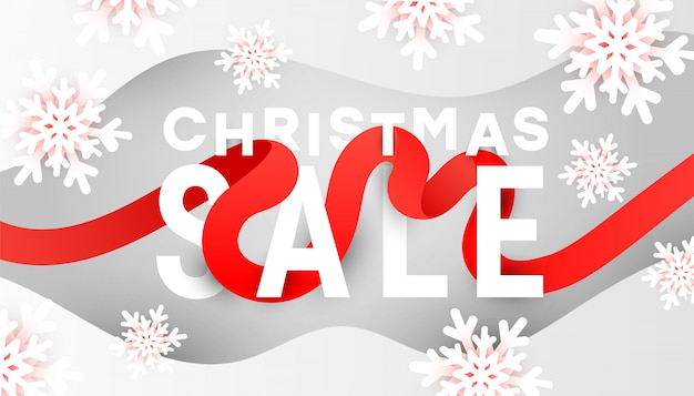 Banner de venta de feliz navidad con copos de nieve blancas y ondas de líquido líquido sobre fondo gris