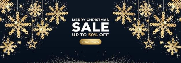 Banner de venta de feliz navidad con copos de nieve de brillo dorado y estrella.
