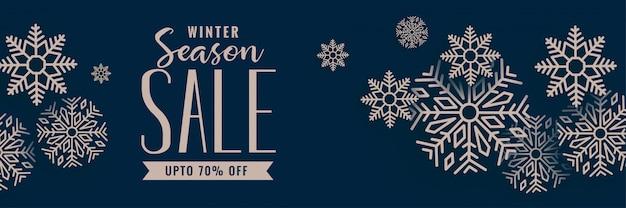 Banner de venta de feliz navidad con decoración de copos de nieve