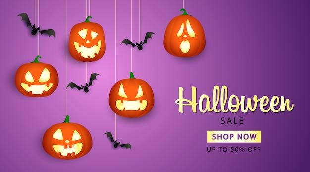 Banner de venta de halloween con linternas de calabaza