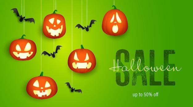 Banner de venta de halloween con murciélagos y linternas de calabaza