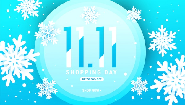 Banner de venta de invierno 11.11 con copos de nieve blancas en un marco de círculo azul con lugar para el texto.