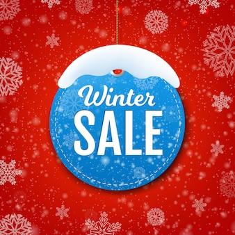 Banner de venta de invierno con nieve y etiqueta de círculo