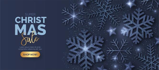 Banner de venta de navidad azul con copos de nieve brillantes