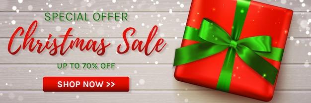 Banner de venta de navidad con caja de regalo.