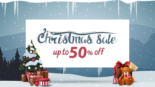 Banner de venta de navidad con cajas de regalo y árbol de navidad