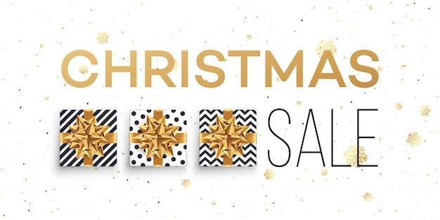 Banner de venta de navidad con cajas de regalos con lazo de oro.