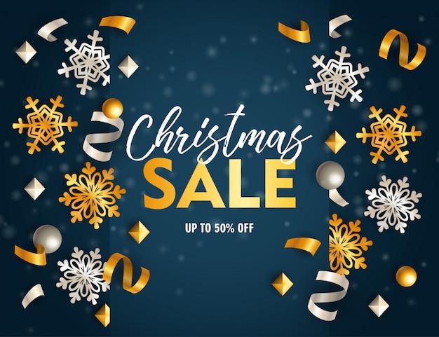 Banner de venta de navidad con cintas y escamas en suelo azul
