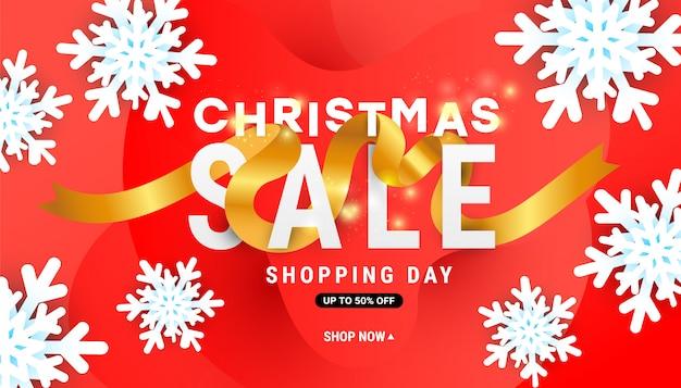 Banner de venta de navidad con copos de nieve de aire y cinta dorada