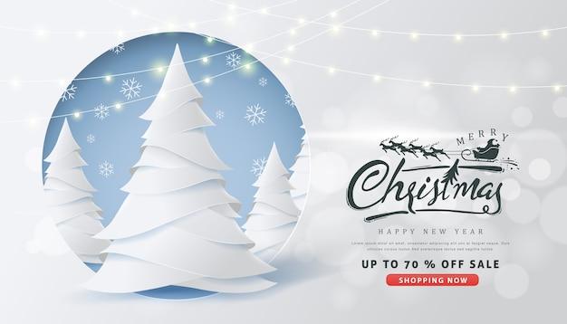 Banner de venta de navidad con letras caligráficas de navidad y renos de trineo de papá noel