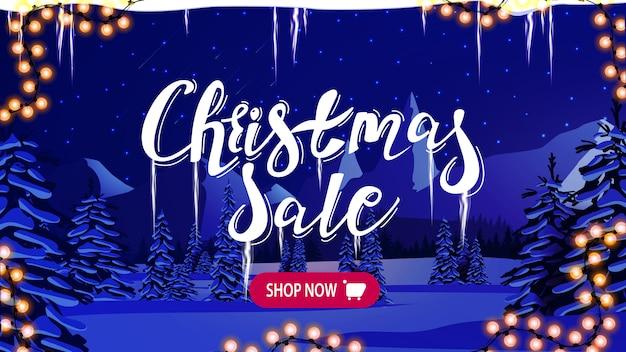 Banner de venta de navidad con noche azul en paisaje de invierno