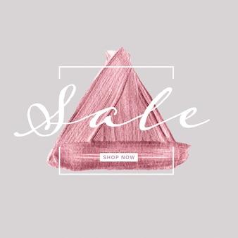 Banner de venta con pincel de triángulo de oro rosa pintado sobre fondo gris