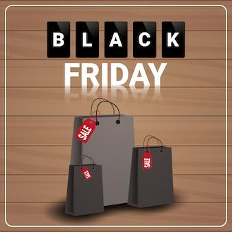 Banner de venta de viernes negro con bolsas de compras en madera con textura