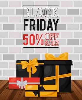 Banner de venta de viernes negro con cajas de regalos