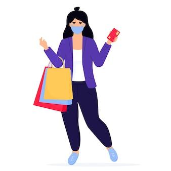 Banner de venta de viernes negro. chica en una mascarilla protectora con bolsas de compras y tarjeta de crédito