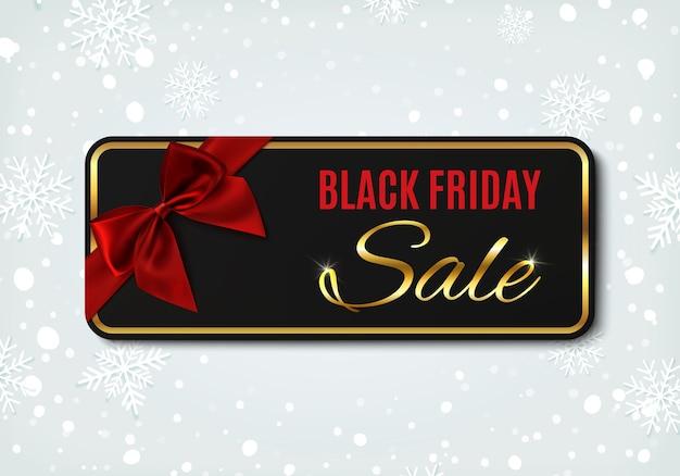 Banner de venta de viernes negro con cinta roja y lazo, sobre fondo de invierno con nieve y copos de nieve. plantilla de diseño para folleto o banner.