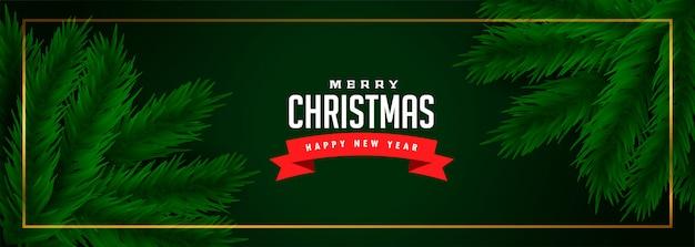 Banner verde feliz navidad con hojas de pino