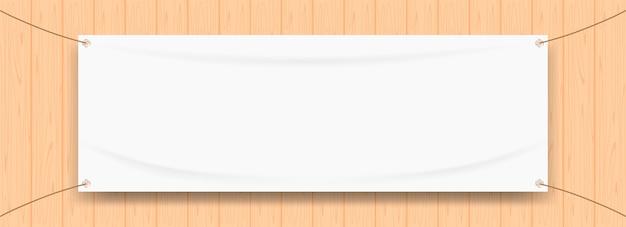 Banner de vinilo en blanco blanco sobre marco de madera