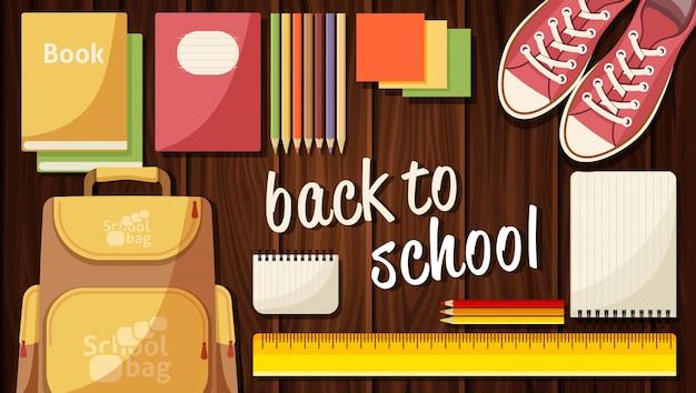 Banner web plano en la escuela, utensilios escolares, libros escolares.
