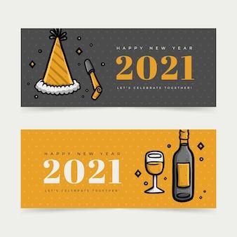 Banners de año nuevo 2021 con sombreros de fiesta y champán.