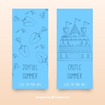 Banners azules con castillo de arena y palas
