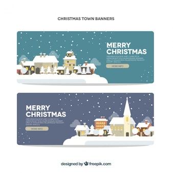 Banners de feliz navidad con pueblos nevados