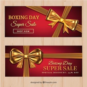 Banners de descuento de boxing day con lazo dorado