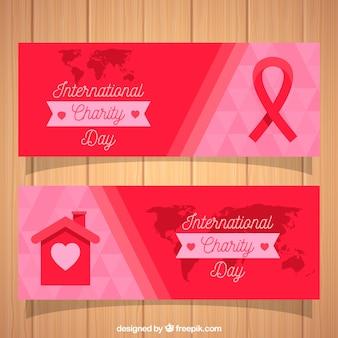 Banners del día de la caridad con lazo y casa