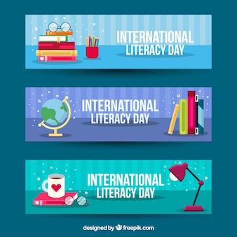 Banners del día internacional de alfabetización en diseño plano