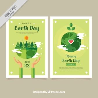 Banners del día de la madre tierra con vegetación en diseño plano