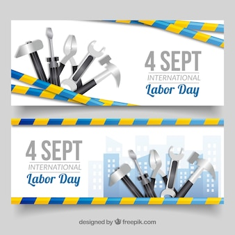 Banners del día del trabajo con herramientas y fecha