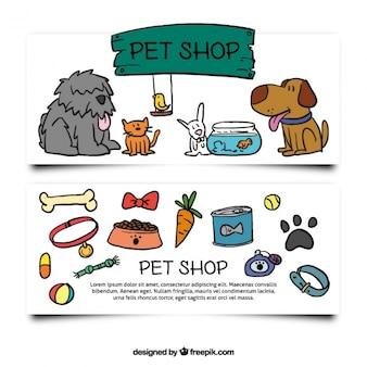 Banners dibujados a mano con accesorios y mascotas
