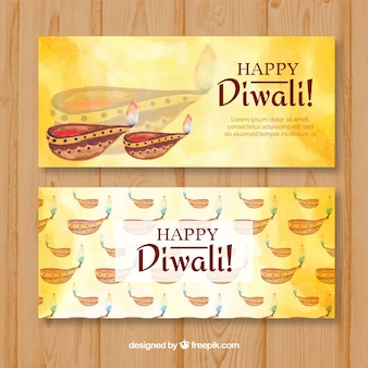 Banners de diwali con lámparas de aceite de acuarela