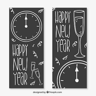 Banners esbozados de año nuevo en estilo pizarra