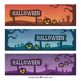 Banners de halloween con calabazas y tumbas