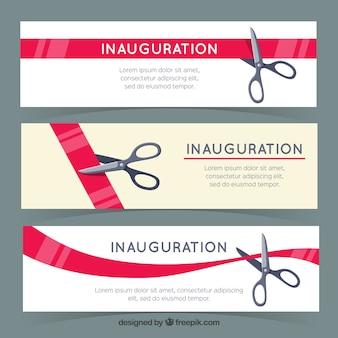 Banners de inaguración con tijeras cortando cinta