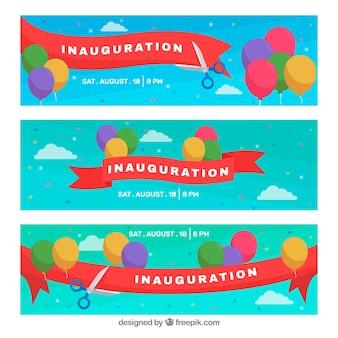 Banners de inauguración con tijeras cortando cinta