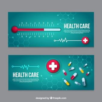 Banners médicos con termómetro y pastillas