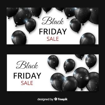 Banners modernos de black friday con globos realistas