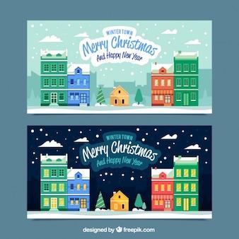 Banners de navidad y feliz año nuevo con casas de colores