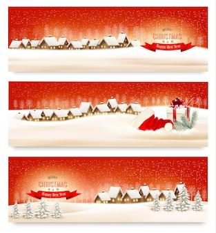 Banners navideños de vacaciones con pueblos.