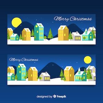 Banners de pueblo navideño con diseño plano