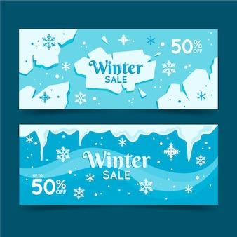 Banners de rebajas de invierno en diseño plano