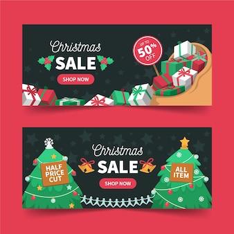 Banners de rebajas navideñas con regalos y árboles.